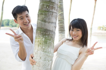 Young Asian couple in love on the beach.  Stock Photo - 13717702