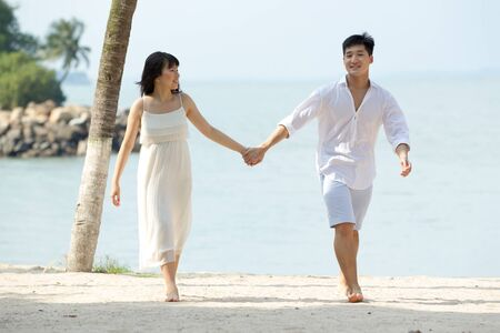 happy asian couple: Young Asian couple in love on the beach.