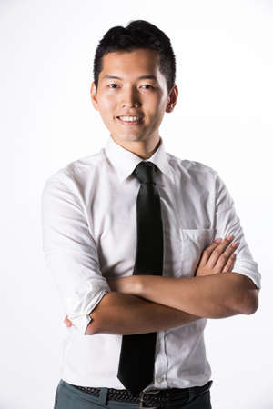 Happy Asian business man with his arms crossed. Stock Photo - 13867191