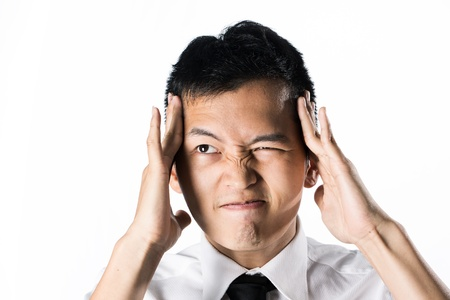 Asian business man holding his head. Conceptual image. Stock Photo - 13867149