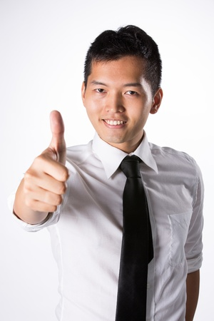 korean man: Happy Asian business man with thumbs up.