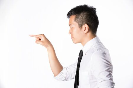 Asian business man pointing his hand to left. Room left for your message. Stock Photo - 13867095
