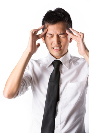 man front view: Asian business man holding his head. Conceptual image. Stock Photo