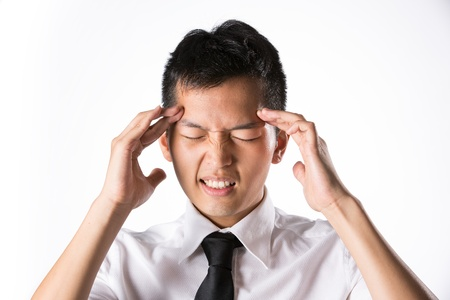 Asian business man holding his head. Conceptual image. photo