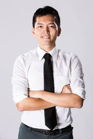 Happy Asian business man with his arms crossed. Stock Photo - 13867161