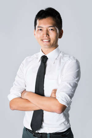 Happy Asian business man with his arms crossed. Stock Photo - 13867156