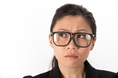Portrait of a angry Asian Business woman looking to side. photo