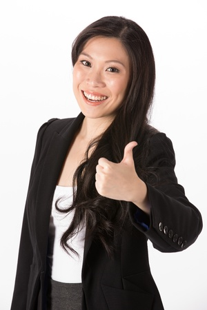 thumbsup: Portrait of happy Asian woman with her thumb pointing up.  Isolated on a white background. Stock Photo