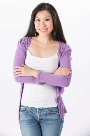 cardigan: Happy Asian woman in casual clothes. Isolated on white background.