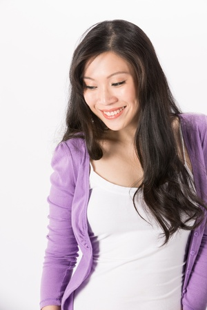 cardigan: Happy Asian woman looking down. Isolated on white background. Stock Photo