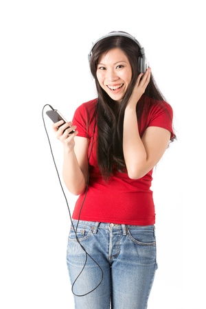 Beautiful Asian woman wearing headphones and listening to the music. photo