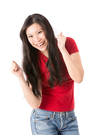 cheering people: Happy Asian woman with her arms in the air cheering. Isolated on white.