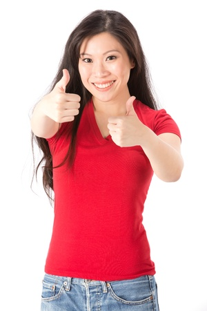 Happy Asian woman with both thumbs up in approval. Isolated on white background. photo