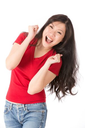 Happy Asian woman with her arms in the air cheering. Isolated on white. Stock Photo - 14041761