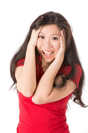 Asian woman looking pleasantly surprised. Isolated on white photo