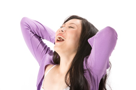 Happy Asian woman with her arms up behind her head. Isolated on white. Stock Photo - 13959881