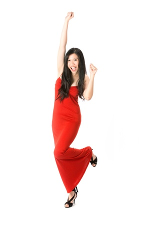Happy Asian woman in red dress celebrating. Isolated on white. Stock Photo