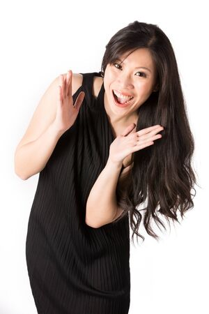 Asian woman looking very happy. Isolated on white. photo