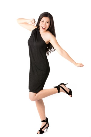 Happy Asian woman in black dress ready for night out. Isolated on white. photo