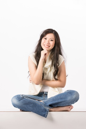 Happy Asian woman in casual clothes. Isolated on white background. photo