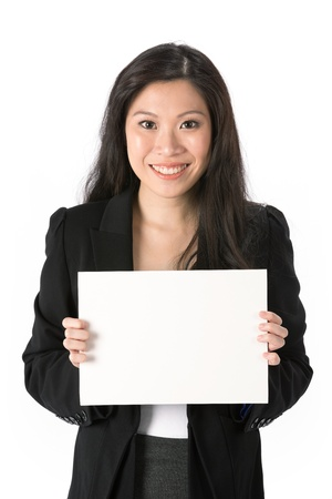 Asian Business woman holding an empty white sign. photo