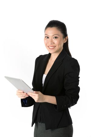 Asian Woman holding tablet computer. Isolated on white background.  photo