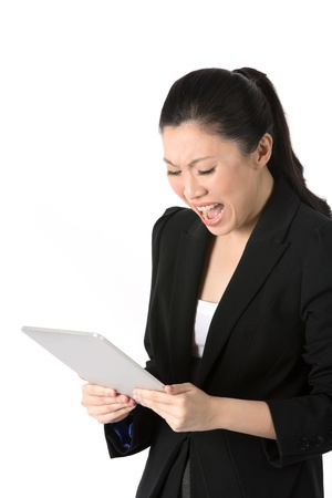 Stressed Asian woman reading her tablet touch pad. Isolated on a white background  photo