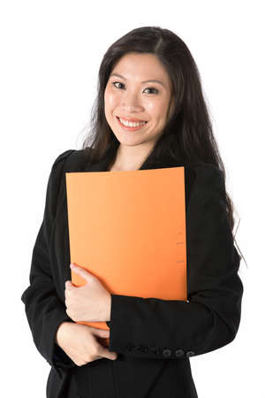 Portrait of a happy looking business woman a folder. Isolated on white background. photo