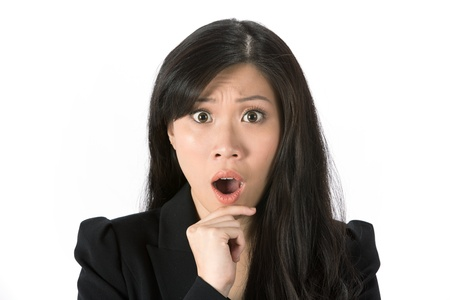 is astonished: Asian woman looking shocked and surprised  Isolated on white