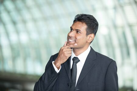 Happy Indian business man at the office. Stock Photo - 14604226