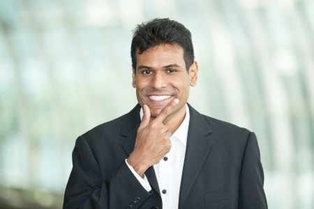 Happy Indian business man at the office. Stock Photo - 14604217