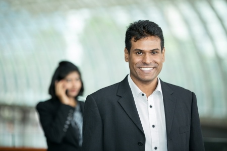 meeting place: Happy Inian Business man in a corporate environment.  Stock Photo