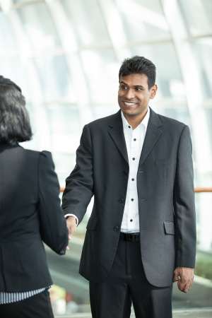 Indian business man and woman shaking hands. photo