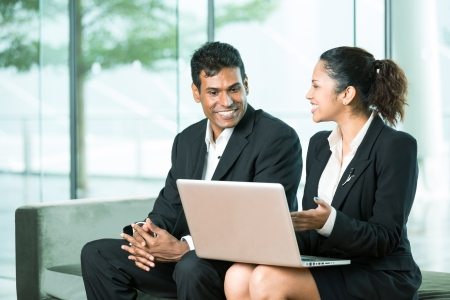 Happy Indian Business team working together around a laptop Stock Photo - 14604044