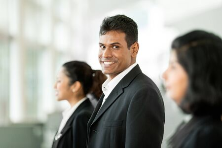 Happy   successful Indian business team at the office   photo