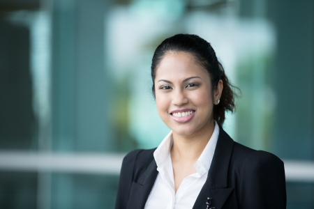 woman in business: A portrait of a young Indian business woman at the office  Stock Photo