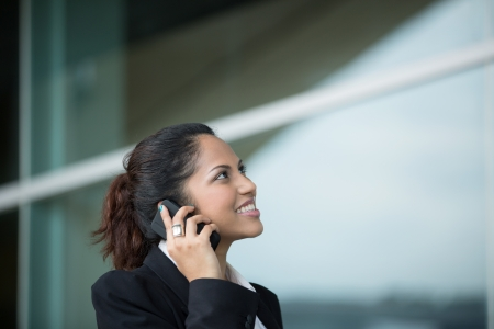 Portrait of an Indian business woman using cell phone  photo