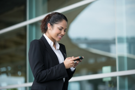 wireless telephone: Portrait of an Indian business woman using cell phone  Stock Photo