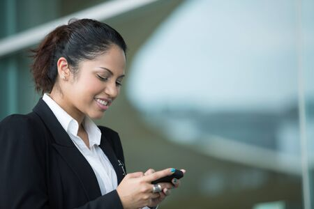 Portrait of an Indian business woman using cell phone Stock Photo - 14608166