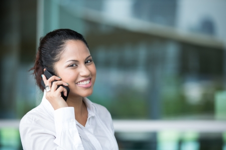 Portrait of an Indian business woman using cell phone Stock Photo - 14608169