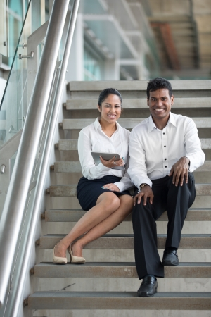Happy Indian Business man and woman looking at a digital tablet. Stock Photo - 14604183