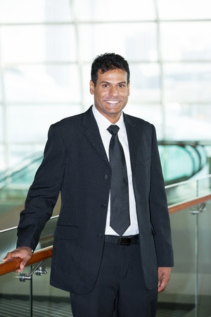 Happy Indian business man at the office. Stock Photo - 14604253