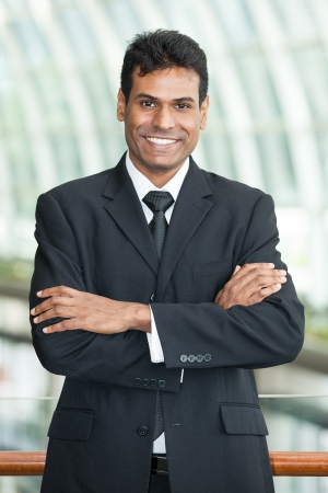 Happy Indian business man at the office. Stock Photo - 15812259