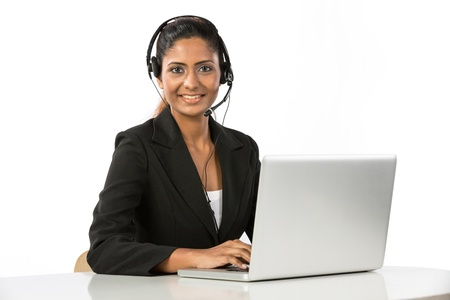 Portrait of a happy young Indian female call centre employee with a headset. Isolated on a white background. photo