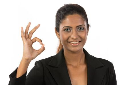 indian professional: Happy Asian woman doing OK symbol with her hand. Isolated on white background. Stock Photo