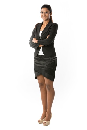 young businesswoman: Full length Portrait Portrait of a happy Indian business woman. Isolated on a white background. Stock Photo