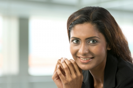 indian ethnicity: Portrait of a happy Indian business woman. Stock Photo