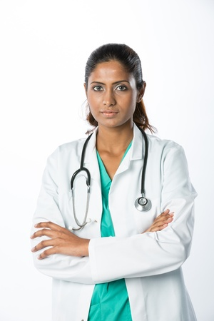 Female Asian doctor wearing a white coat and stethoscope. Isolated on white. photo