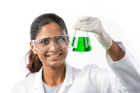 analyst: An Indian scientific researcher or student looking at a liquid solution. The background has been Isolated.