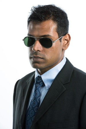 Young Indian business man wearing a suit and sunglasses. Isolated against a white background Stock Photo - 15162979
